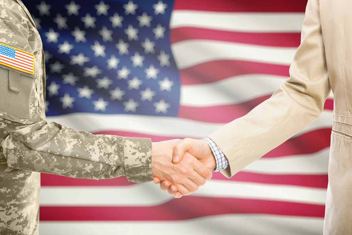 public sector data consulting and analytics, shaking hands with a US army official